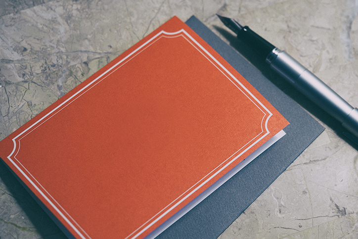 A card, envelope, and pen