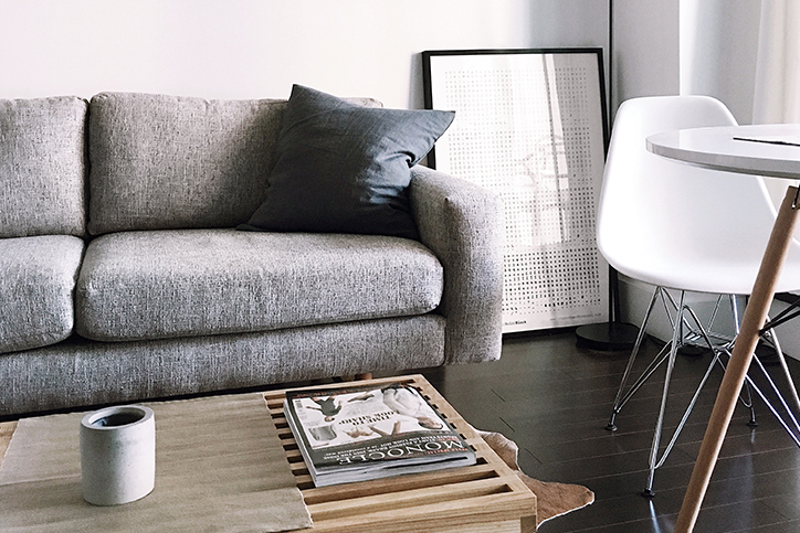 A living room with a couch and table