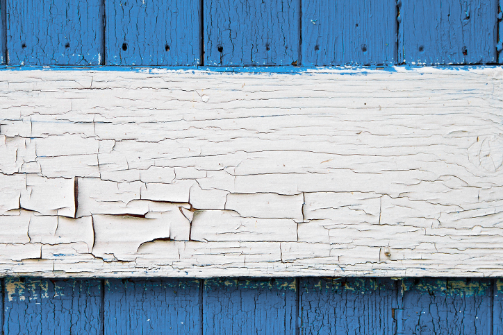 Peeling blue and white paint