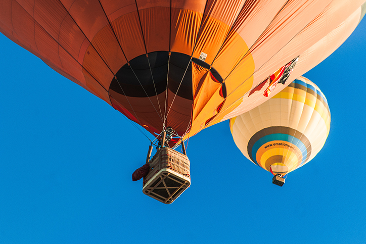Two hot air balloons in the air