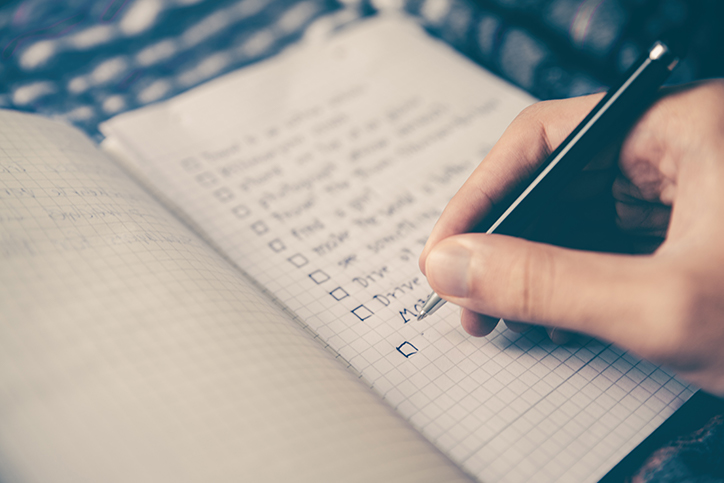 A person writing a to do list
