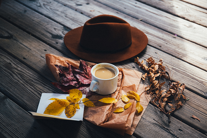 Fall leaves, hot chocolate, and a hat