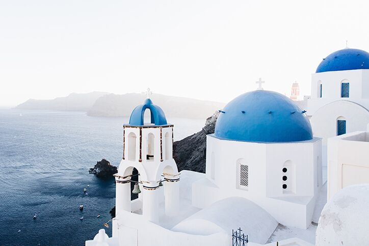 White buildings with blue roofs in Santorini Greece