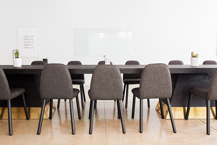 An empty conference room with a table and chairs