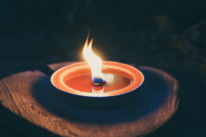 A lit citronella candle outside