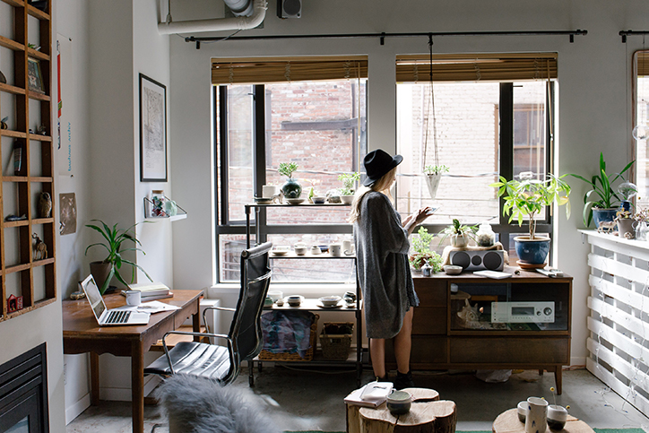 A woman running her small business from her home office