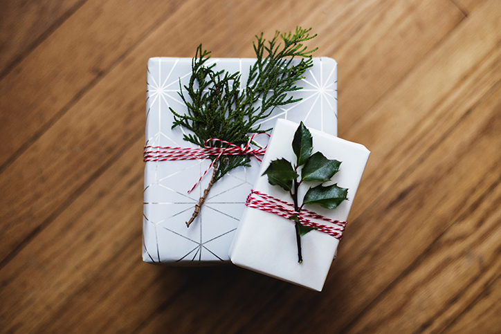 Two gifts wrapped in paper and ribbon