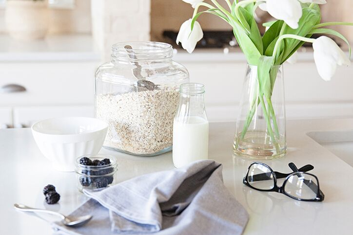 Ingredients on a kitchen counter next to a pair of eyeglasses