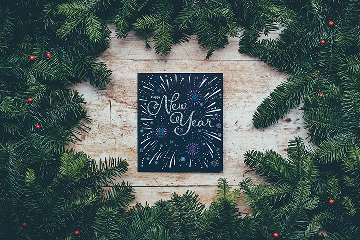 A Happy New Year sign in the middle of a wreath