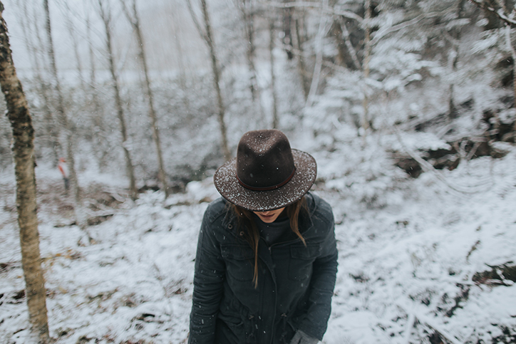 A woman in a hat walking in the snow