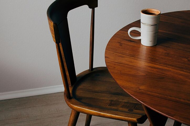 A coffee mug sitting on an empty table