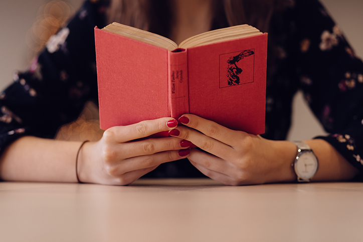A woman reading a little red book