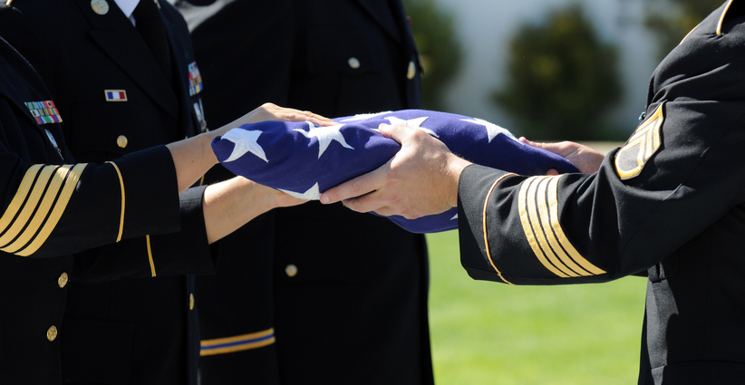 Flag is prepared that draped the casket of one of America's fallen heroes.