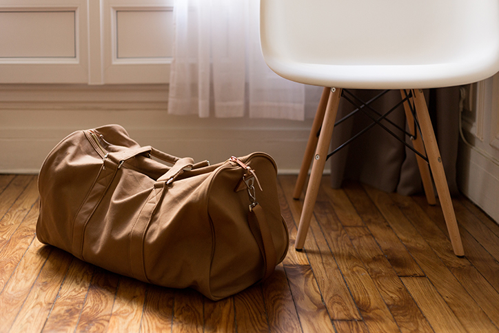 A brown suitcase sitting on the floor