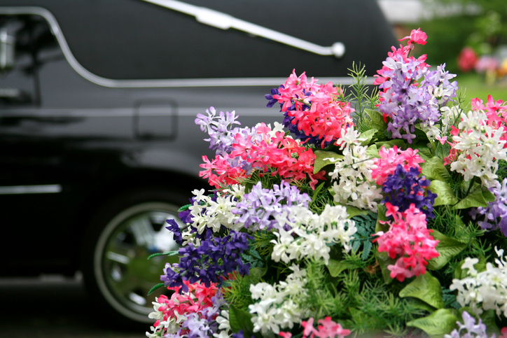 hearse next to floral arrangement