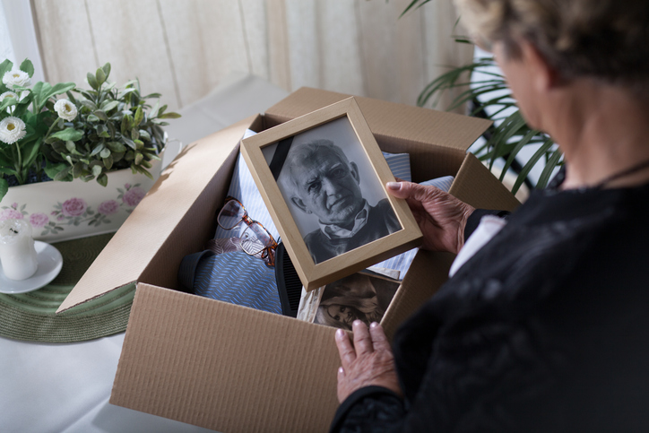 woman looking at framed photo
