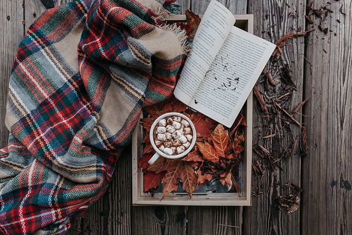 fall leaves, scarf, book, and hot chocolate