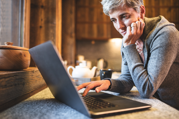 woman searching on laptop