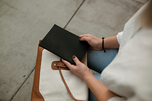woman holding notebook