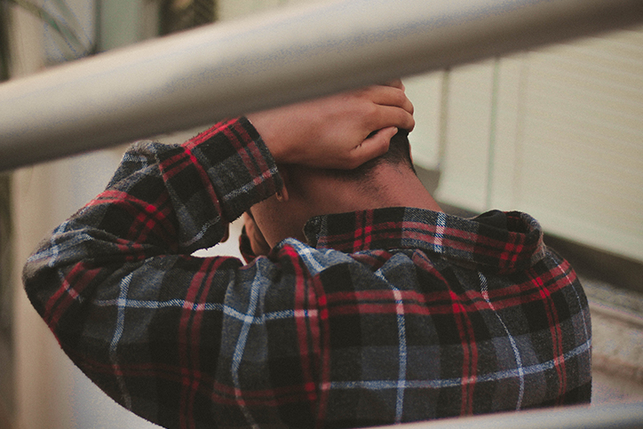 man in flannel grieving