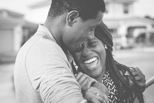 A black and white picture of a couple laughing