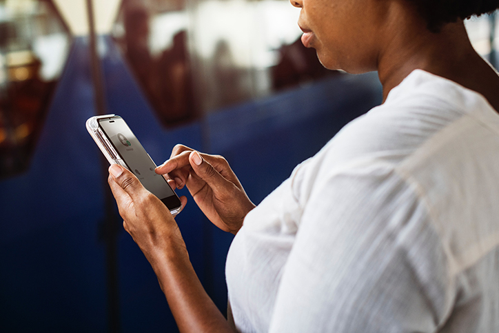 woman looking at smartphone