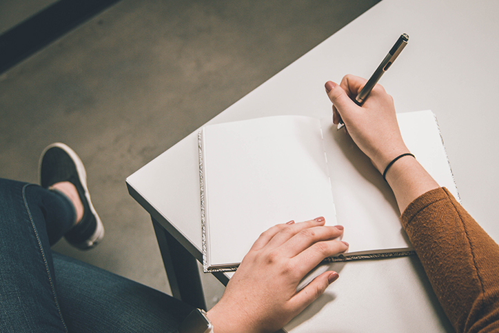 taking notes in a notebook