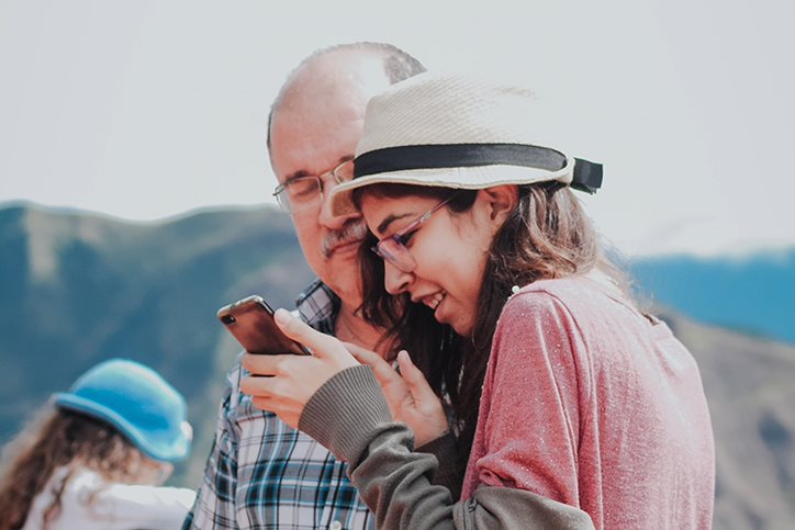 Two people looking at smartphone