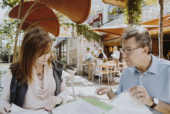 Two people preplanning outside at a table