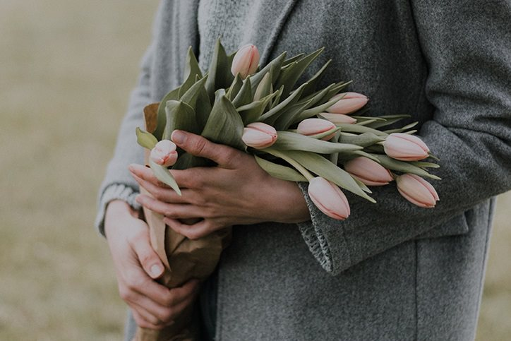 person holding tulips