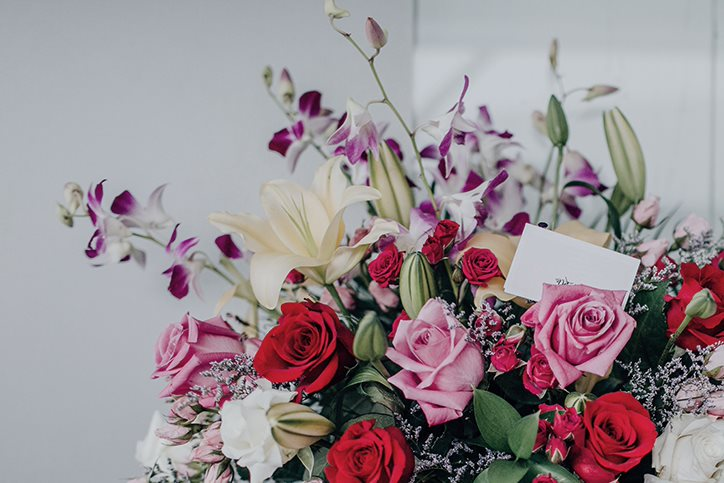 A floral arrangement with a card in it