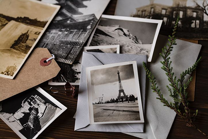 A bunch of old photos laid out on a table