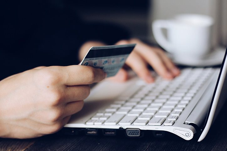 A person paying online with a credit card