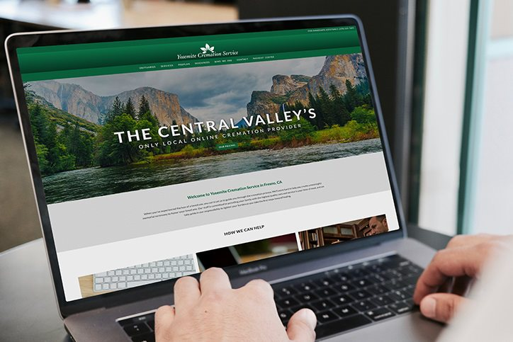 Close up of Yosemite Cremation Service website on a laptop