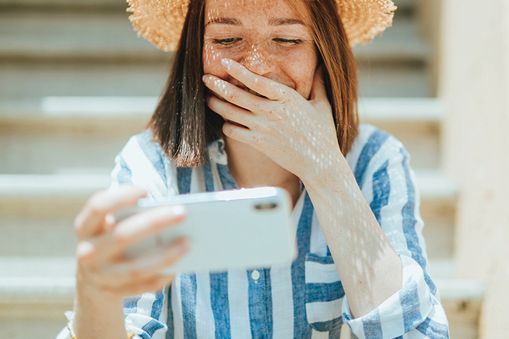 Woman watching a video on a smartphone