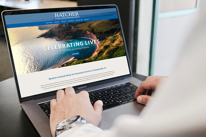 Hatcher Funeral Home website on a laptop