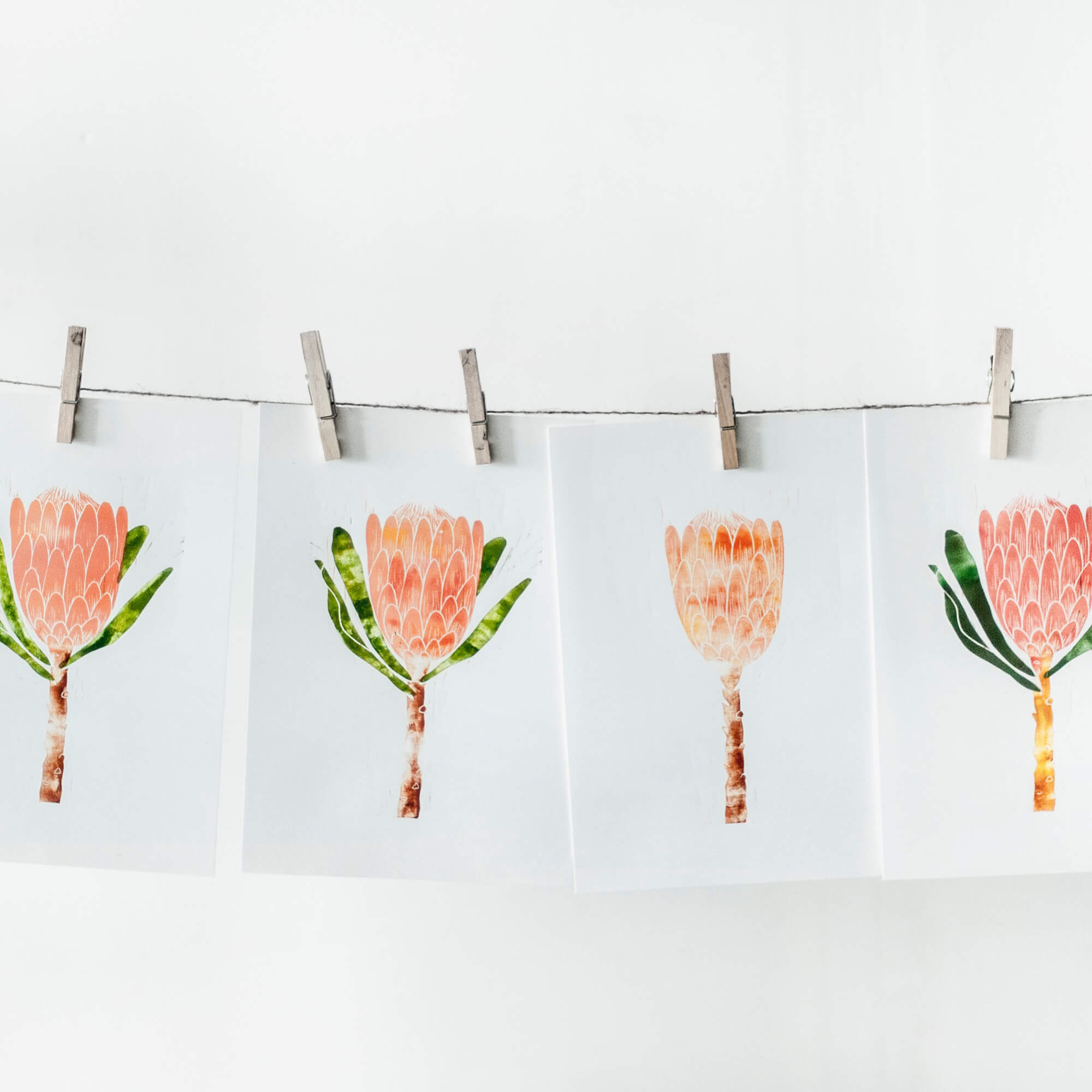 photos on a string with clothespins